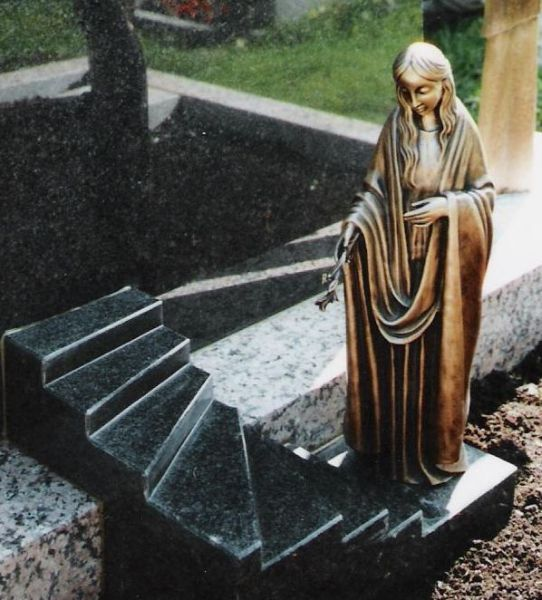 Bronze Figure on sculpted Stairs